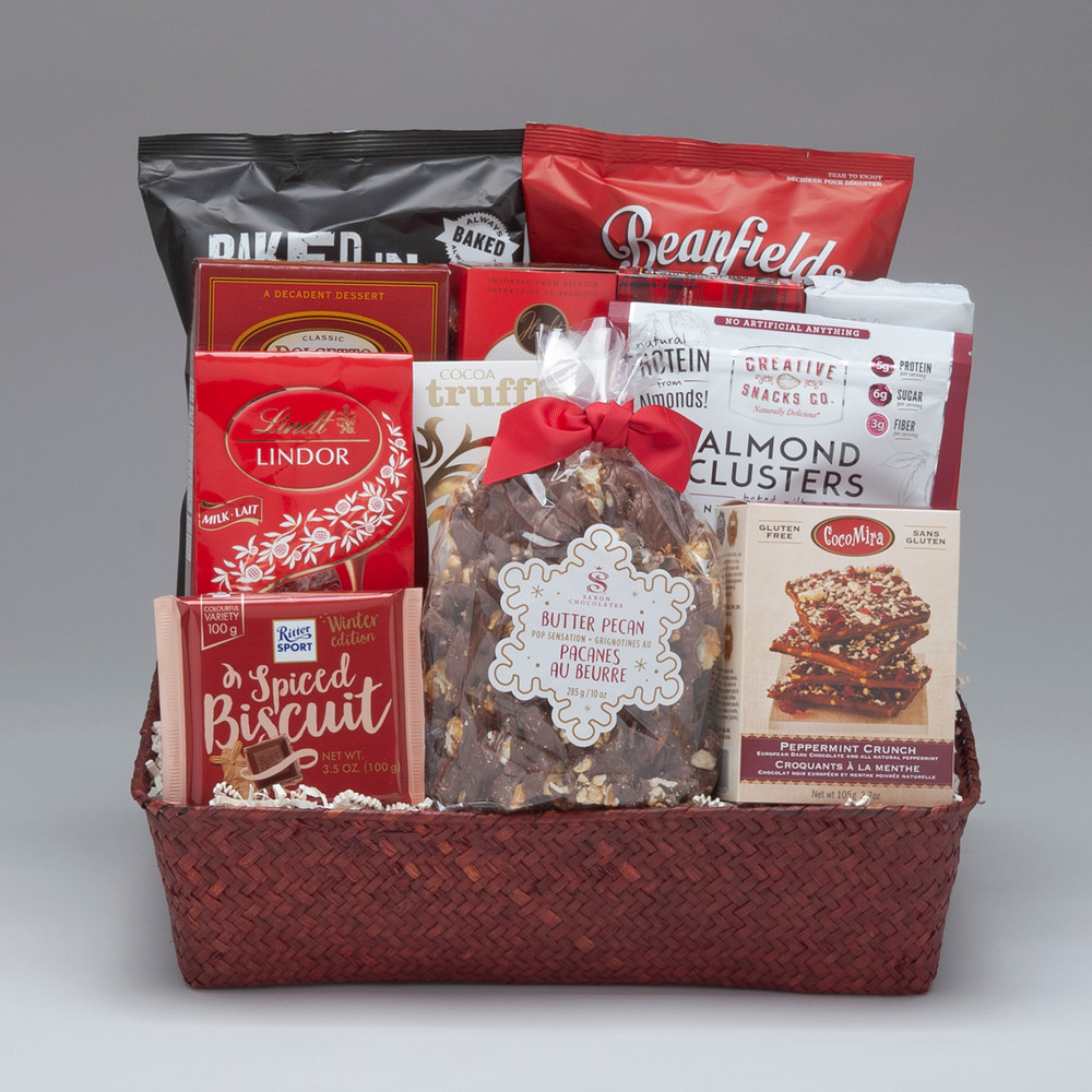 Intended for a group to share, this large gift basket comes loaded with a fabulous selection of snacks, treats & chocolates, including our favourite Saxon Chocolate Pop Sensation... the best decadent popcorn snack we've tried! It is definitely Very Merry, and perfect for office groups or friends & family to share!