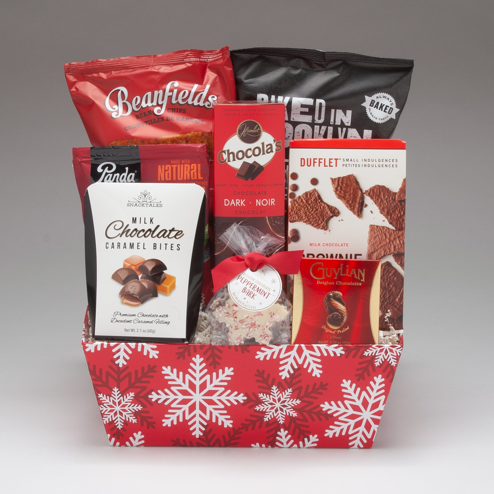 Intended for a group to share, this medium-sized gift basket is filled with a fabulous selection of snacks, treats & chocolates, including the amazing Dufflet Milk Chocolate Brownie Crisps! This merry arrangement is perfect for friends, family or office groups.