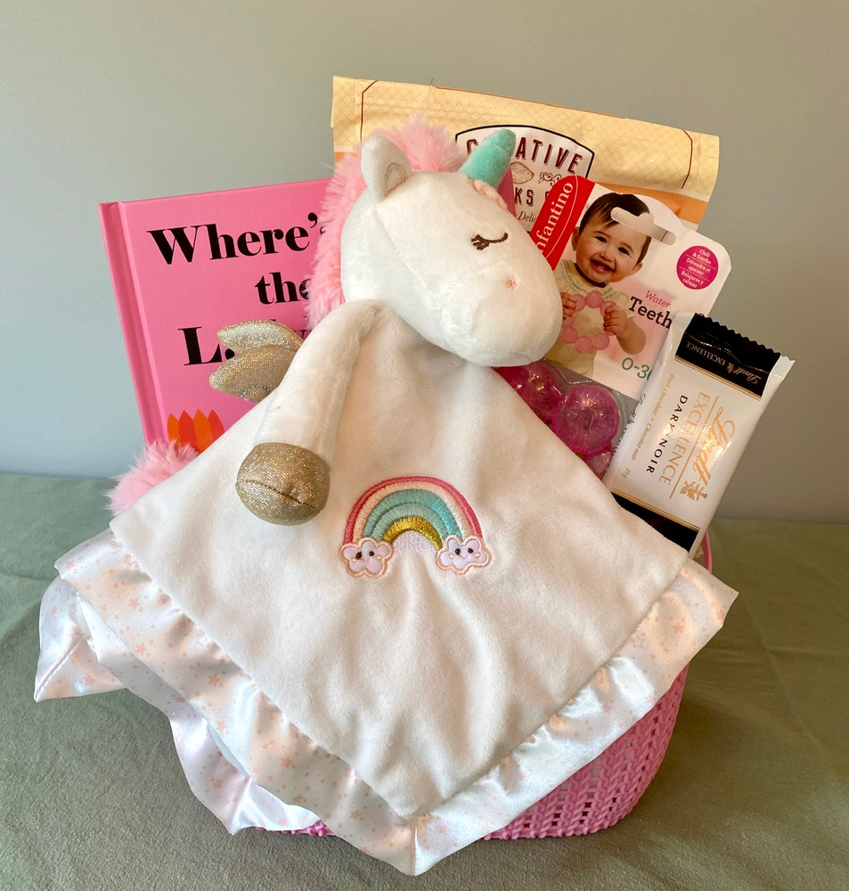 Perfectly sweet in every way, this lovely gift basket includes a beautiful book, teething ring, and features the Douglas Baby Unicorn Snuggler...oh so soft and cuddly! Perfect for the new Baby GIRL this gift also includes some treats for Mom & Dad, and is sure to be appreciated.