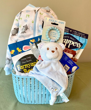 Perfectly sweet in every way, this lovely gift basket includes a beautiful book, sleeper, and features the Douglas Baby Blue Bear Teether...oh so soft and cuddly! Perfect for the new Baby BOY this gift also includes some treats for Mom & Dad, and is sure to be appreciated.
