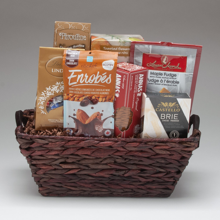 This popular arrangement is filled with our very best selection of traditional gourmet foods: Brie cheese, crackers, cookies & fine European chocolate. It is well suited for a group to share, and is perfect for friends, family & clients.