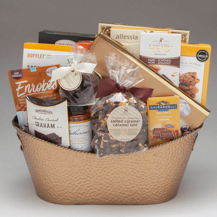 This decadent gift basket is filled to overflowing with a wide range of our very best gourmet foods, many fine foods made right here in Canada by small family run businesses...beautiful sweets by Dufflet, Cookie It Up, Saxon Chocolates, and Rochef Chocolatier, so know that this gift is helping support local! And beyond that, it is the abundance of this gift that really brings the WOW! Delicious! Beautiful! And guaranteed to impress, this gift is perfect for friends, family and clients.