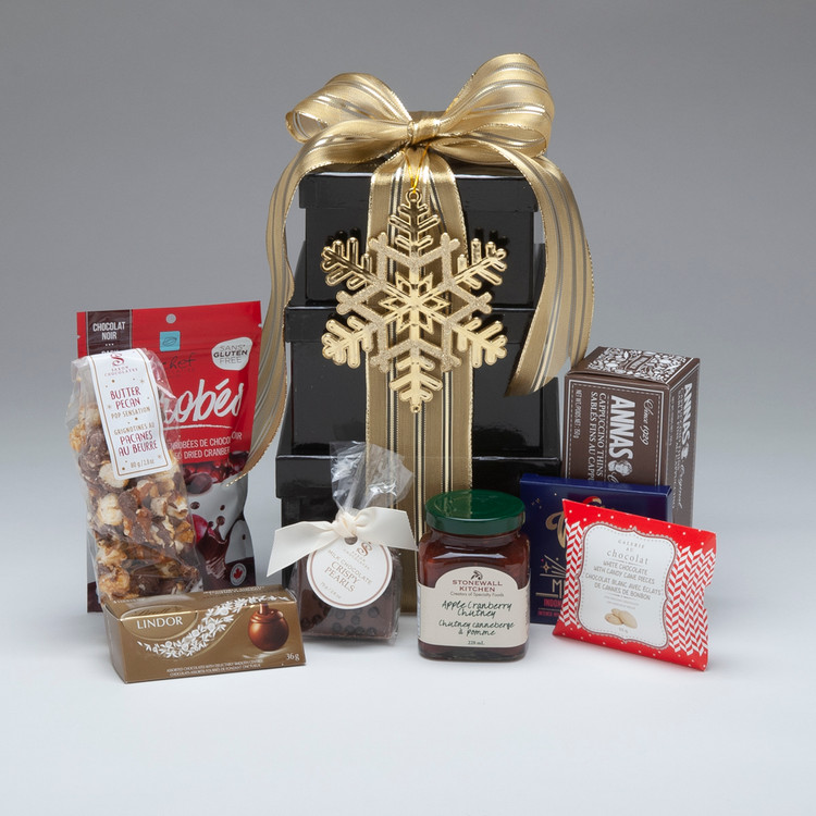 Our Tower of Treats is an elegant and festive presentation of three stacking boxes filled with a delicious selection of snacks and treats, perfect for a small group to share! This also packs well and is ideal for shipping anywhere in Canada.