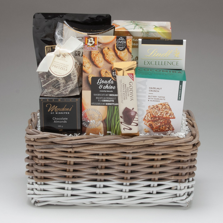 This beautiful Kubu rattan basket is an excellent lasting keepsake, and features some of the yummiest treats we have on offer; CocoMira Toffee Crunch  (oh my!), Saxon Dark Chocolate Sel de Fleur Pretzels, and Morden's of Winnipeg Chocolate Almonds. This gift is sure to impress because of the quality of each item, and is perfect for friends, family & clients!