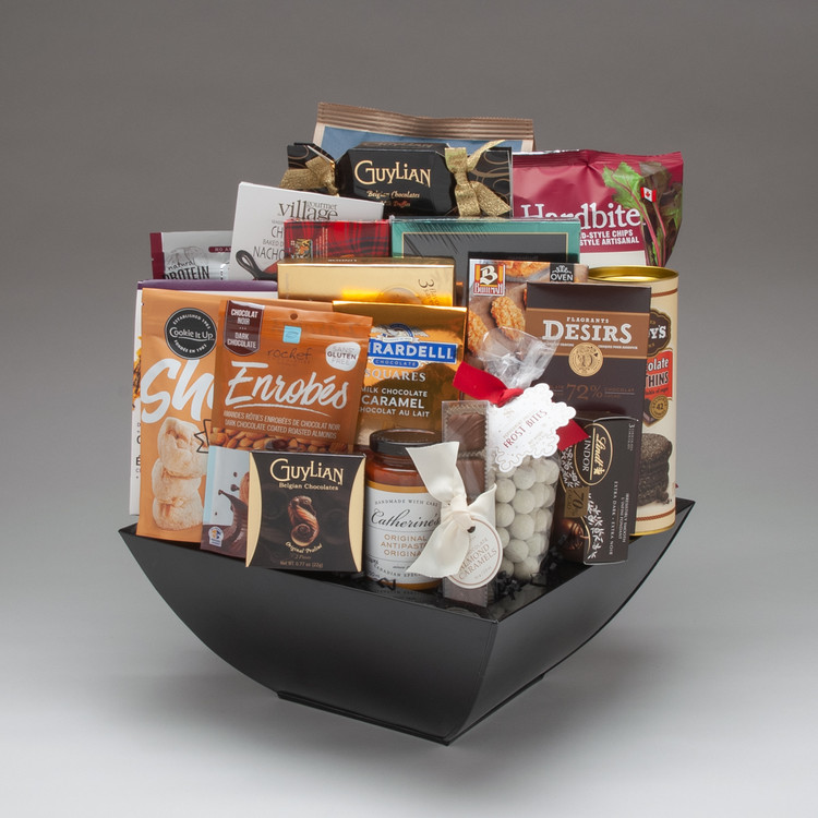 This impressive glossy black metal planter comes abundantly filled for the Holiday Season with every kind of fine sweet and savoury gourmet snack and treat! We are particularly excited about some spectacular Canadian-made fine foods; sweets by Dufflet, Cookie It Up, Saxon Chocolates, and Rochef Chocolatier! Perfect for friends, family, and Clients, this extravagant gift lives up to it's name!
