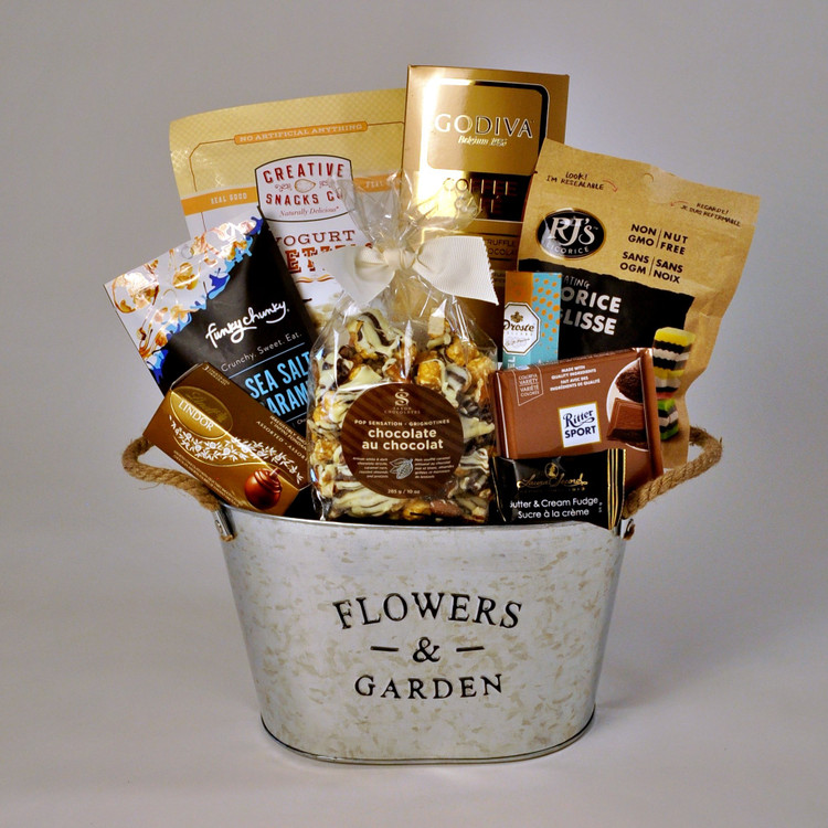 This charming metal basket with Flowers and Garden motif, comes loaded with more sweets than savoury foods, and is perfect for family and friends to open and share! Ideal for Mom on Mother's Day. Yummy! Order online today.