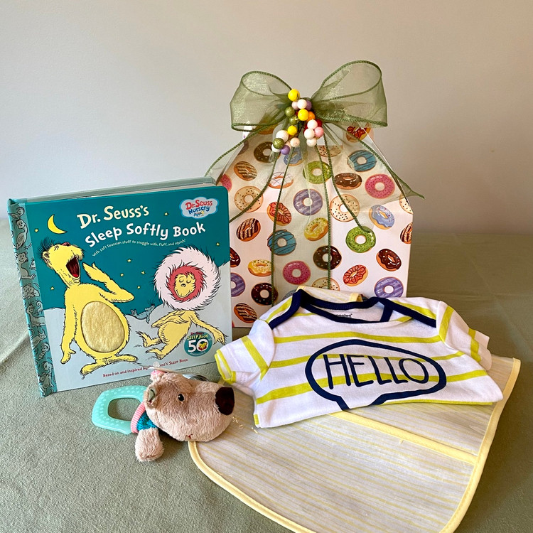 In a world full of sweetly iced donuts, we know that babies are sweeter than all! This fun and adorable box of goodies for Baby is gender neutral and is sure to be appreciated!