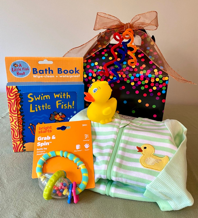This Little Box for Baby- Bath Time is the perfect gift when you need something small but thoughtfully put together. This gift can be customized to make it suitable for BOY, GIRL, or gender neutral, and it includes toys, bath book and sleeper.