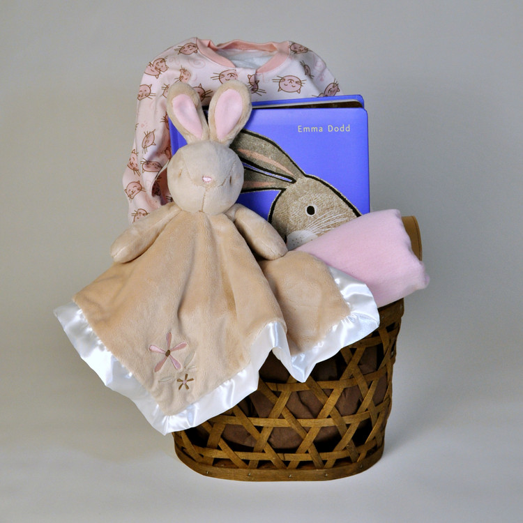 """We love everything about this sweet gift: the open weave storage basket, the oh-so-soft Bunny Snuggler from Douglas Cuddle Toys, the """"Love"""" Board Book by Emma Dodd and more!"""