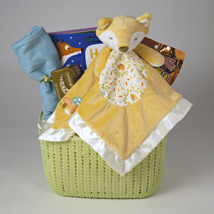 This delightful gift features the Sleepy Fox Snuggler (which has stitched eyes and is oh-so-soft!) by Douglas Baby Cuddle Toys along with a Board book and onesie for the new arrival, and some yummy treats for Mom & Dad! Gender neutral gift.