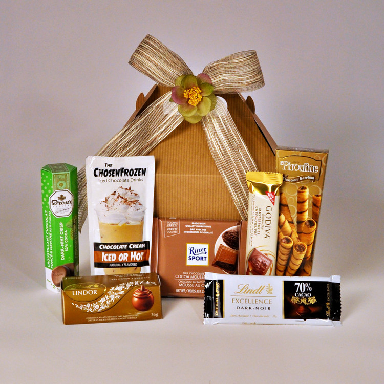 A delightful selection of chocolate treats for the chocolate lover in your life! This little box of goodness is filled with dark, milk, and caramel chocolate. Sure to please the chocolate connoisseur on your gift-giving list!