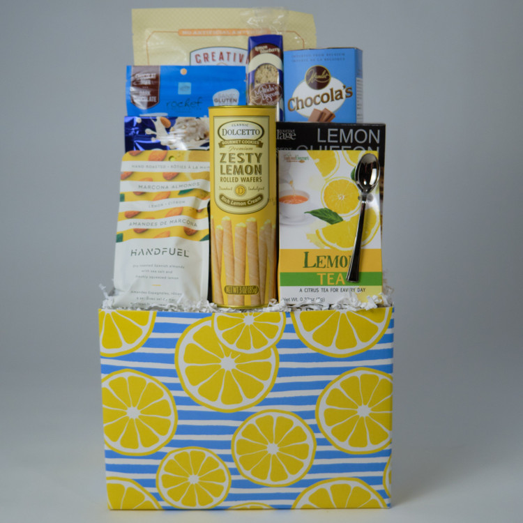 This wonderful selection of lemon flavoured items makes a great Mother's Day present! The cheery box comes packed with rolled lemon wafers, chocolate covered blueberries, tea, lemon Marcona almonds and much more! Sure to please with some chocolate items and lots of lemon, all decorated with a yellow bow!