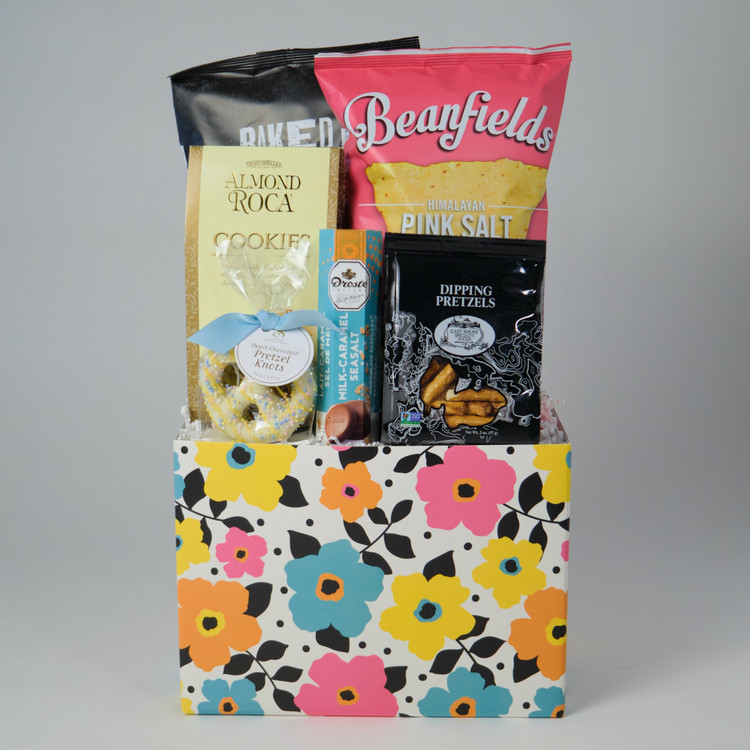 A Mother's Day basket that will delight anyone who receives it! Contains specialty chips and cookies, as well as chocolate and pretzels. Featuring Saxon Pearl White Chocolate Covered Pretzels.