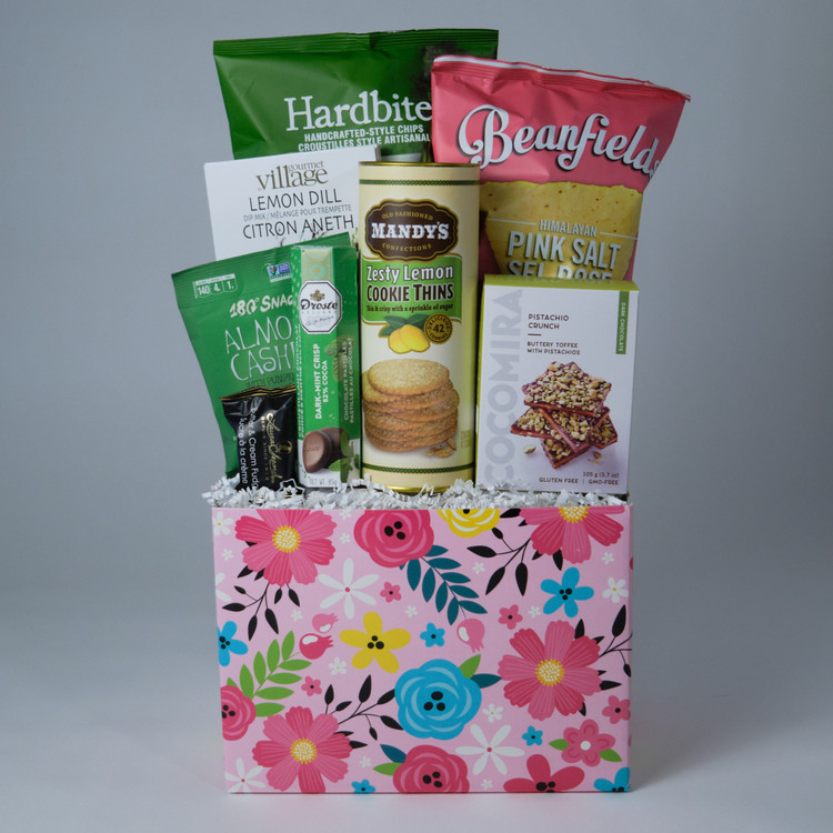 This floral motif box comes loaded with delightful treats! Mandy's Lemon Cookie Thins and two kinds of specialty, gluten free chips plus chocolate and fudge are sure to please the lucky recipient of this basket!