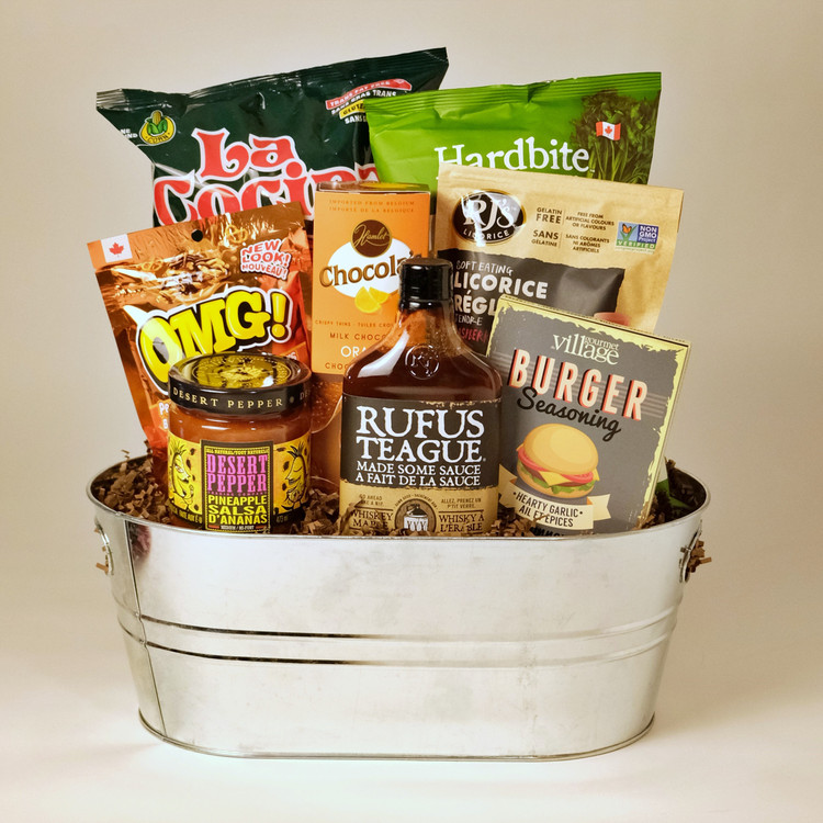 It's grilling time!! This BBQ bucket comes with some fabulous flavours, good snacking, and a bit of attitude...Rufus Teague Made Some Sauce Whiskey Maple and Desert Pepper Pineapple Salsa are all of the above! Give this gift and you will definitely make someone's day! The re-useable container doubles as an ice bucket for drinks on the patio - makes a great house warming gift!
