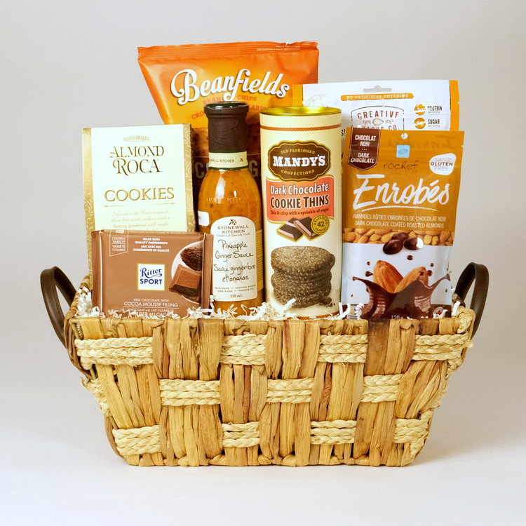 This fabulous selection of snacks comes in a light colored woven basket, perfect for summer gifting! Chocked full of great snacks, including a couple healthier options and gluten free bean chips. This basket is sure to delight anyone who receives it!