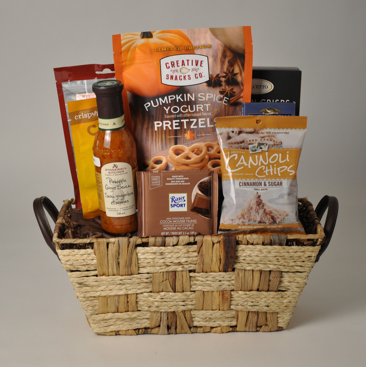 Happy Thanksgiving! This basket welcomes in fall with its Pumpkin Spice Yogurt Pretzels Limited Edition by Creative Snacks and Pineapple Ginger Sauce by Stonewall Kitchen. Dolcetto Tuscan Crisps are great for holiday entertaining and the Cinnamon Sugar Cannoli Crisps along with delicious chocolate by Ghirardelli and Ritter will satisfy anyone's sweet tooth craving!