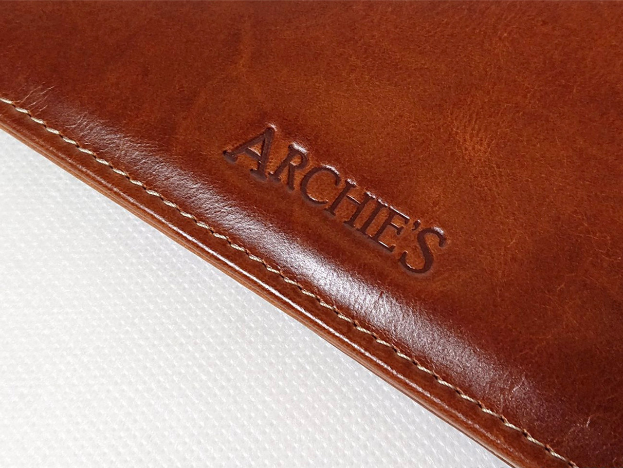 Archie's notebook and leather cover, imprint
