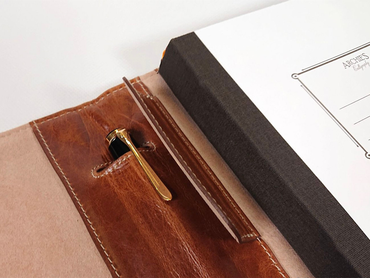 Archie's notebook and leather cover, inner spine detail