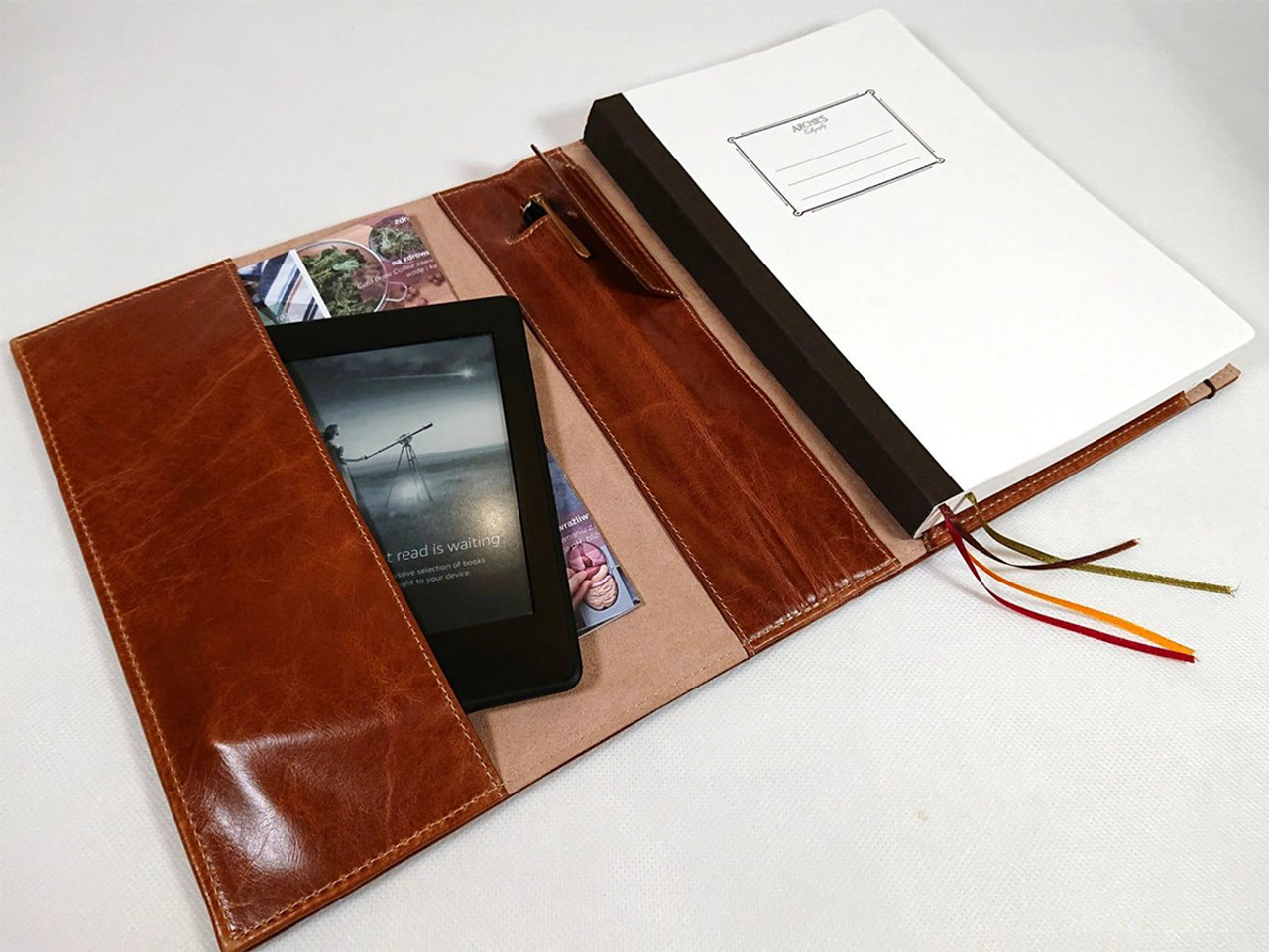 Archie's notebook and leather cover, open