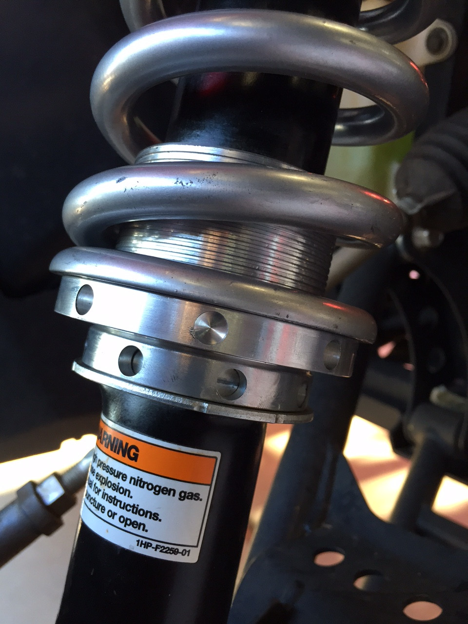 Pre load adjuster is threaded so you can adjust the ride height any place you choose