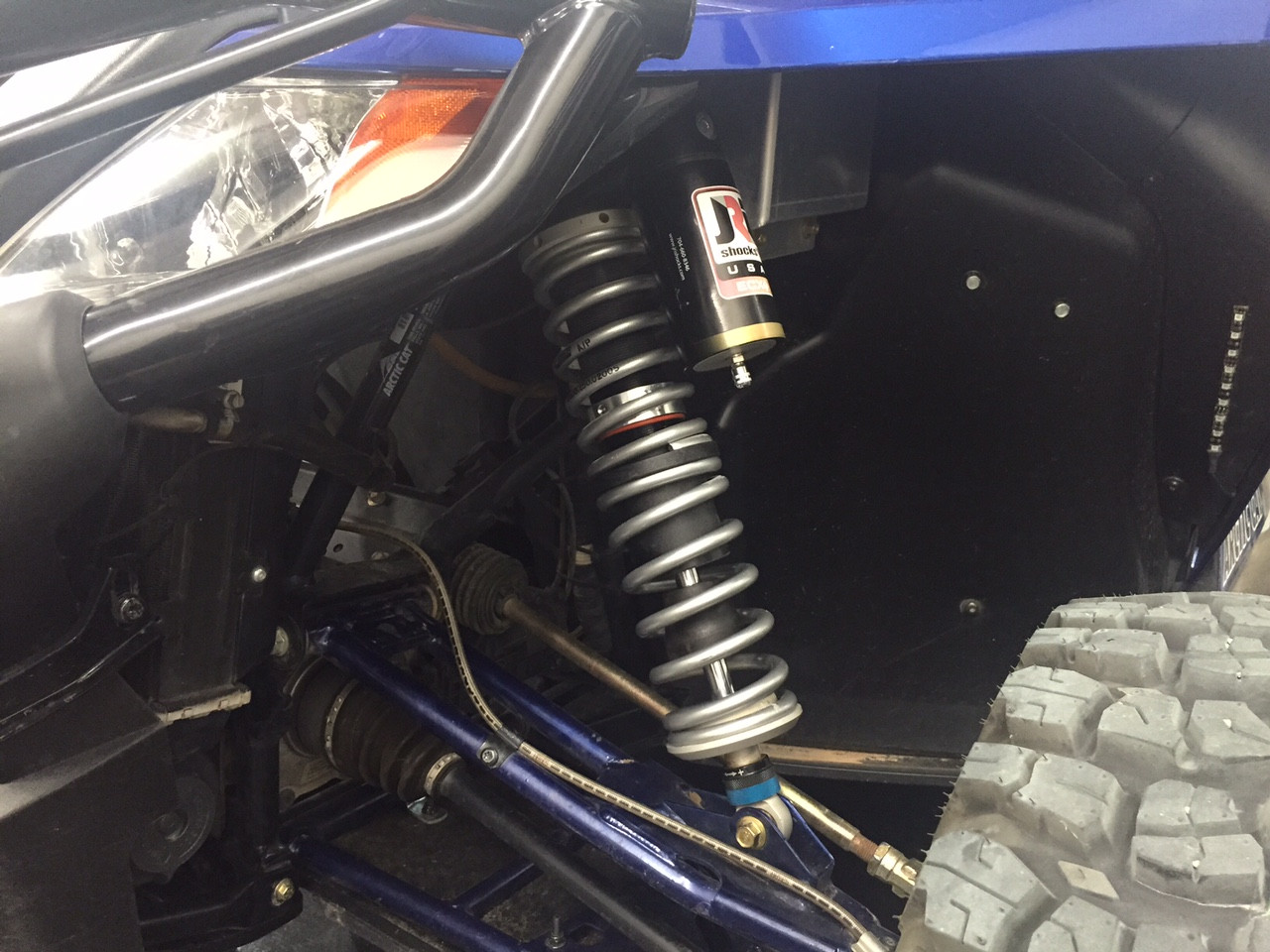 Front shocks installed with dual rate spring kit and cross over rings