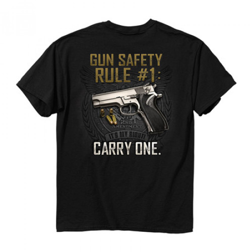 """(""""Gun Safety Rule #1:Carry One."""") •Heavyweight 6oz. 100% Preshrunk-cotton-tees.. •Short set-in sleeves and a two needle hem around the sleeves and bottom •Comfort cut for maximum maneuverability •Double stitched seamless collar, taped neck and Shoulders •High Quality screen printed artwork that will withstand hundreds of washes..."""