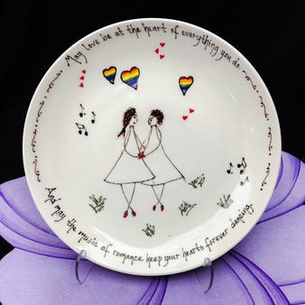 "Pottery Mountain - This bowl has a line drawing of a female couple with rainbow hearts and music notes. ""May love be at the heart of everything you do.  And may the music of romance keep your hearts forever dancing."""