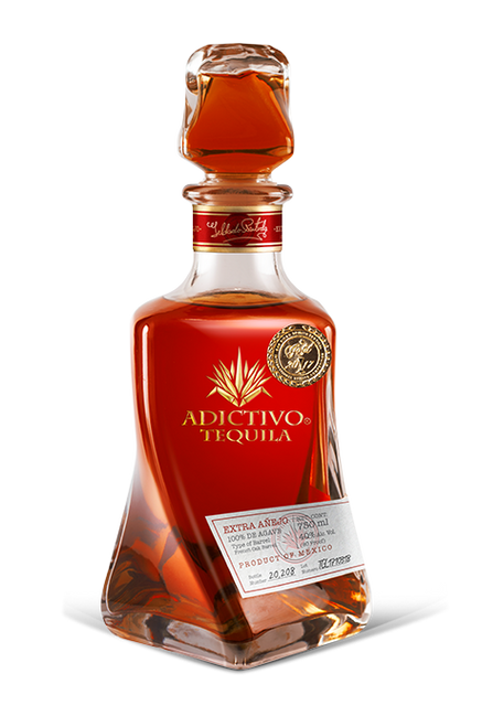 Buy Tequila Adictivo Extra Añejo is 100% pure Blue Agave, dark amber with reddish hues with excellent roasted flavor, sweet and fruity aromas. Online at sudsandspirits.com and have it shipped to your door.