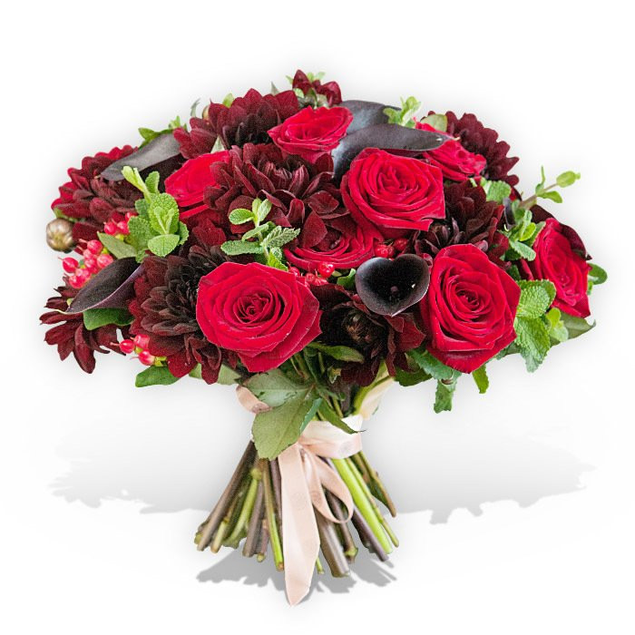 Flower bouquet with large red roses, dark pink calla lilies and red carnations
