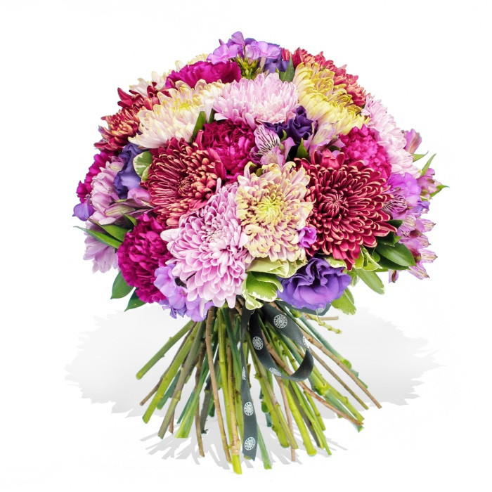 A sweet mix of chrysanthemum flowers combined with seasonal foliage and lisianthus blooms.