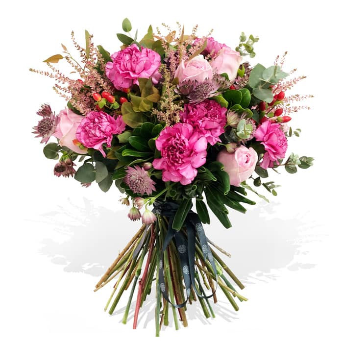 A bouquet with dark and light pink roses mixed with other fresh flowers and foliages