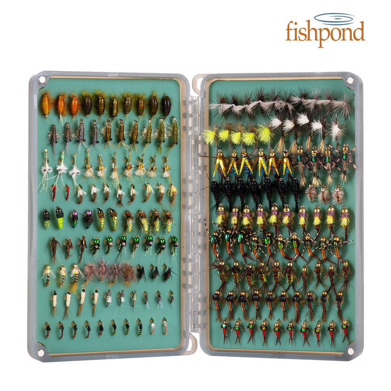 Fishpond Tacky Day Pack 2X Fly Box shown open and full of flies with Fishpond logo.