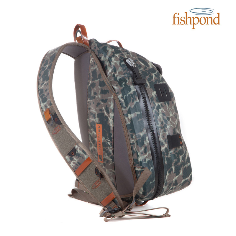 Fishpond Thunderhead Submersible Sling shown in the color Riverbed Camo.