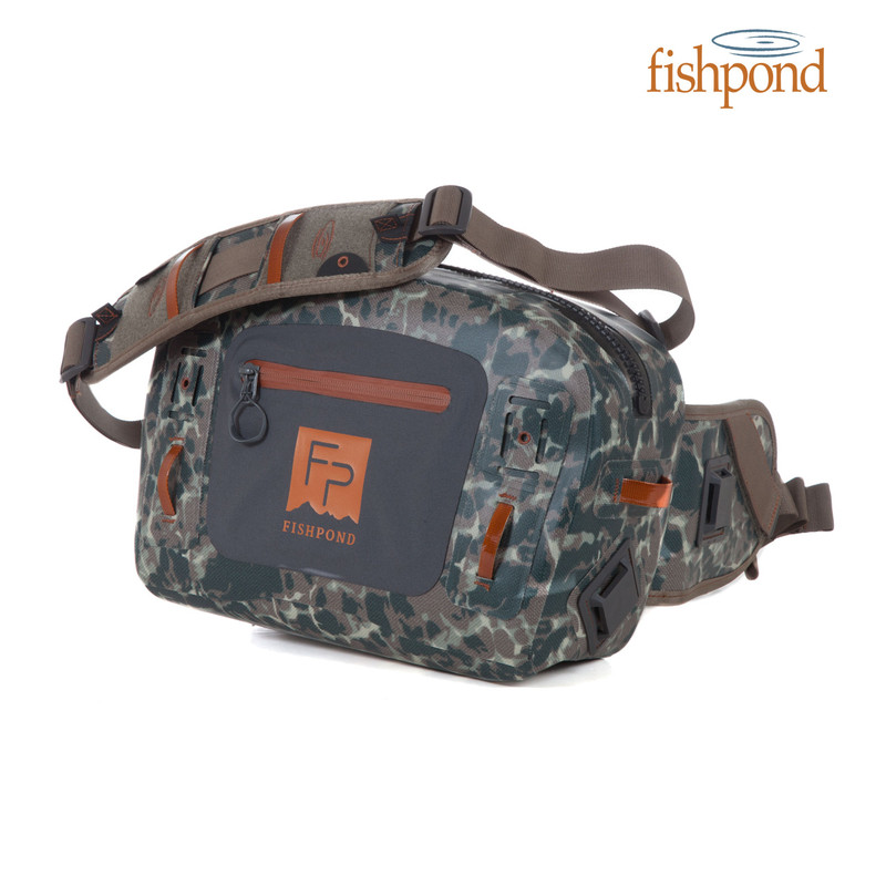 Fishpond Thunderhead Submersible Lumbar Pack shown in the color Riverbed Camo with Fishpond Logo.