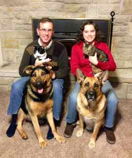 image of Raw Delivery's owner Kris together with her husband Paul, their dogs and cats.