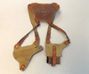 Shoulder holster saddle tan color w/double magazine pouch, adjustable belt clips and basket weave stamping. Back view.  Notice the width of the back plate. It is suede lined to help wick away sweat and is designed to keep the straps from rubbing your neck.