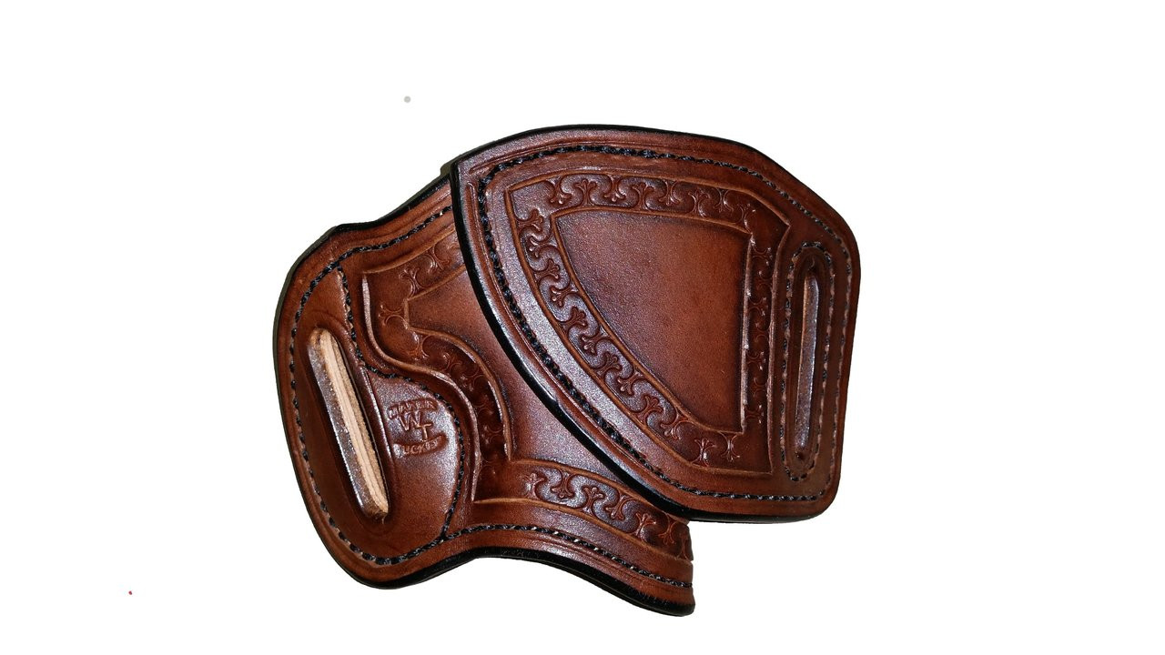 "This HF-2 holster has the following options: Dark brown ""Leather Color"", black ""Thread Color"", ""Fleur di Lis"" border stamping, ""Leather Lining"" and ""Texas Concho"". Price as shone: $205"