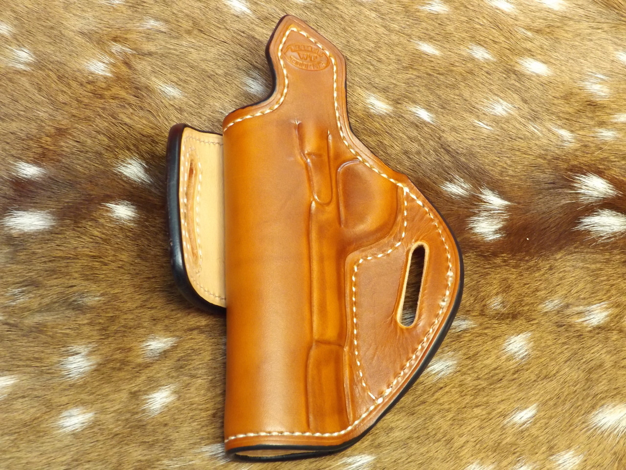 HF-1 saddle tan color, white thread with sweat tab and leather lining. Back view. Notice the burnished and dyed edges.