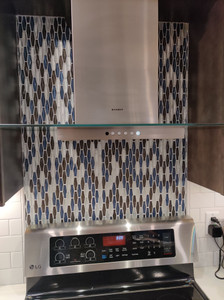 Which materials are perfect for a kitchen backsplash?