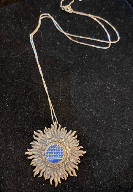 """Blue """"Chaney"""" silver sun necklace with silver chain."""