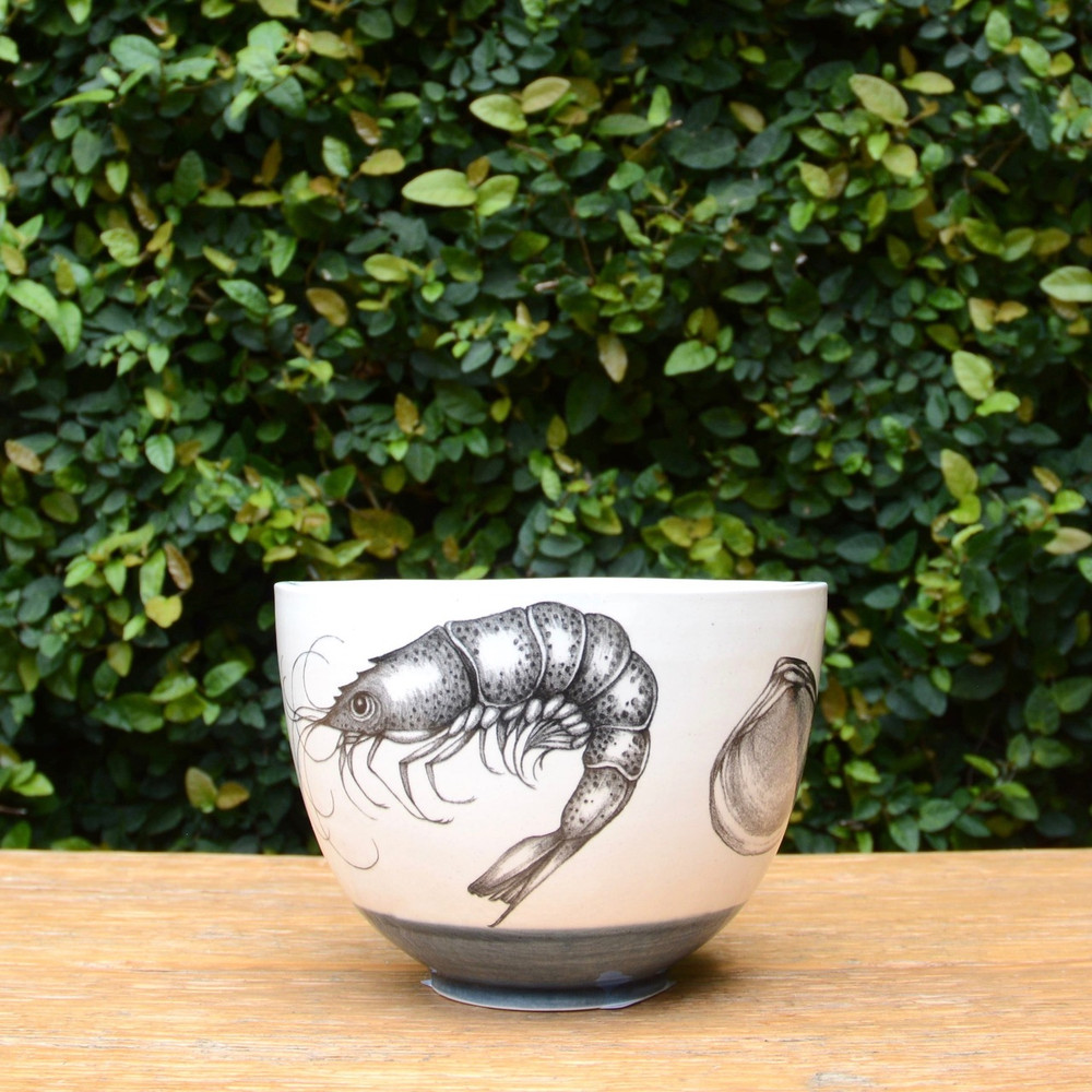 Shrimp Laura Zindel Design handmade ceramic bowls are functional works of art. Each bowl is crafted from earthenware and glazed with our own hand mixed glazes and finished with Laura's signature illustrations.