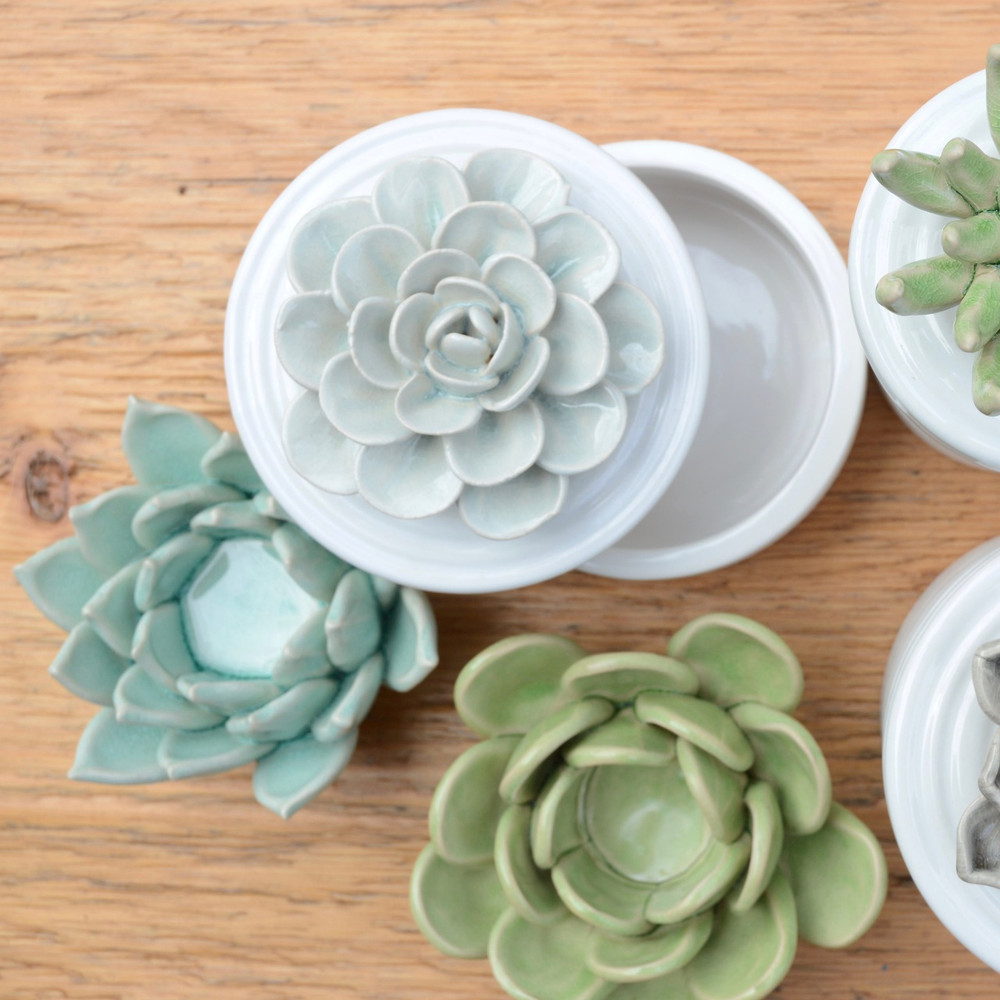 Our Succulent Tea Light Holders are true works of art. Each lovely, simple flower is hand-crafted; each petal is hand-formed. Then, each ceramic piece is given a hand-applied color glaze and a carefully crackled finish.