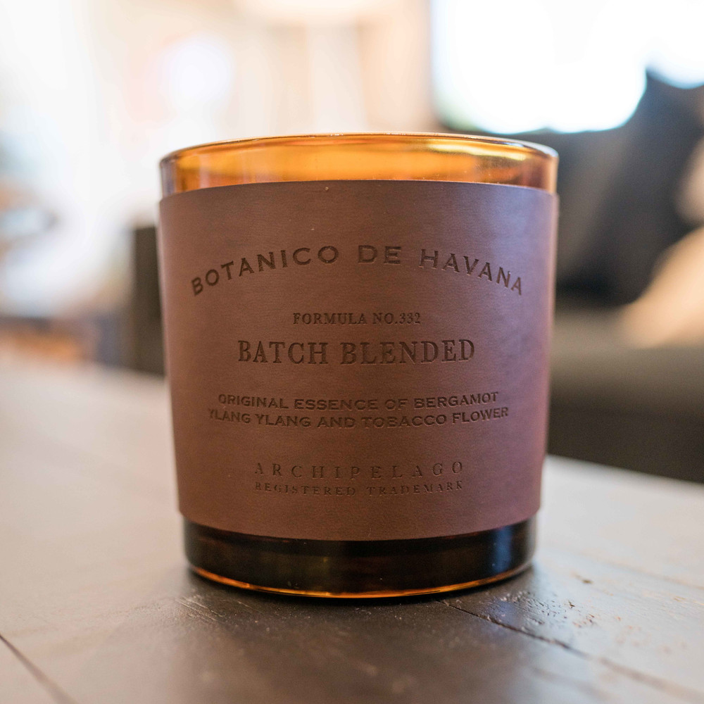 The Botanico de Havana Letter Press Candle features a hand-tooled, cruelty-free leather wrap and a soft, cushioned sole. The tantalizing fragrance blend is created by pairing the spicy and citrusy notes of Bergamot with the leather scent of Tobacco Flower and the delicate floral scent of Ylang Ylang. This luxury candle is carefully hand-poured with a soy wax blend and contains two safe, lead-free cotton wicks.