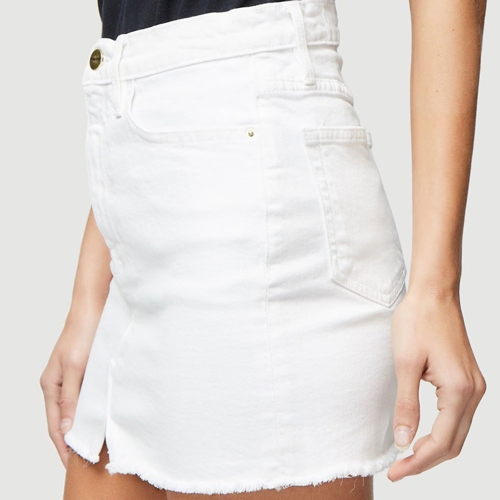Blanc A straight cut mini skirt crafted from premium denim in classic bright white. Features a split front-frayed hem.