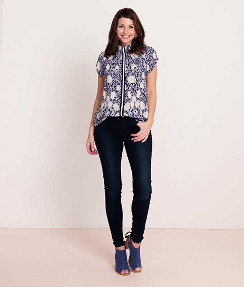 Gardenia Floral Blue/Navy   This elevated staple with its sporty contrast stripe is already a customer favorite! Pair this season's gorgeous new colorways with everything from white jeans, a blazer tor an open cardigan. The blouse can also be worn off the shoulder for a stunning evening look. We recommend sizing down in this style.