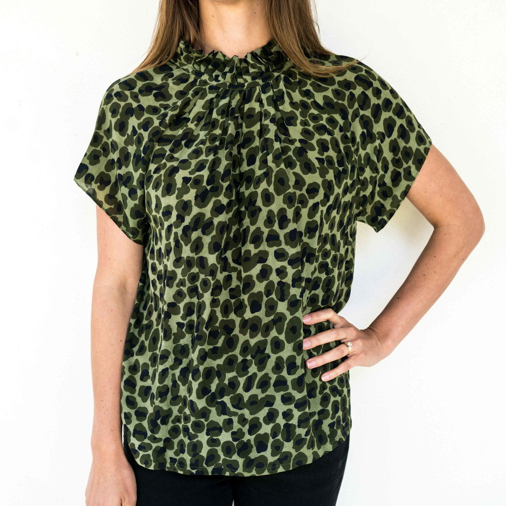 Green Navy Leopard  This versatile blouse is the perfect addition to your already chic wardrobe. Slip this elegant number on for a day at the office, then reverse it for a night out on the town!