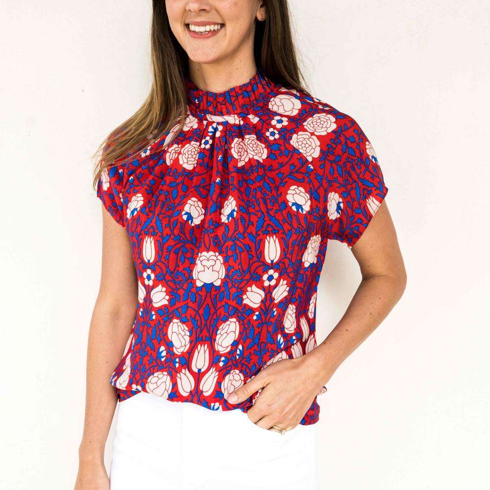 Gardenia Floral  This versatile blouse is the perfect addition to your already chic wardrobe. Slip this elegant number on for a day at the office, then reverse it for a night out on the town!