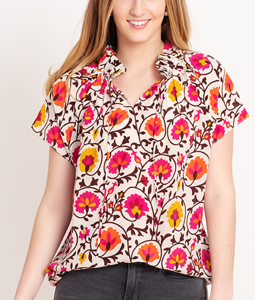 Suzani Floral   This versatile blouse is the perfect addition to your already chic wardrobe. Slip this elegant number on for a day at the office, then reverse it for a night out on the town!