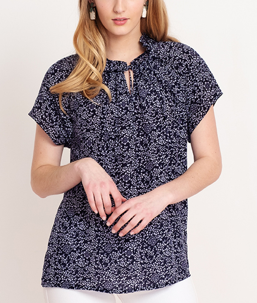French Floral/Navy Blue  This versatile blouse is the perfect addition to your already chic wardrobe. Slip this elegant number on for a day at the office, then reverse it for a night out on the town!